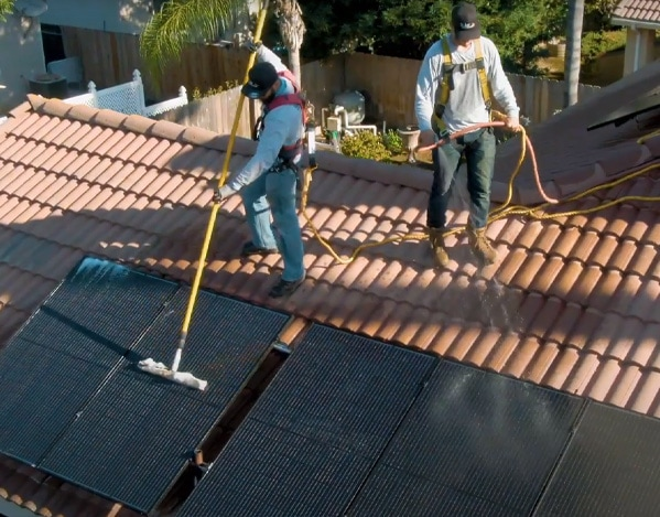 solar panel cleaning crew on roof